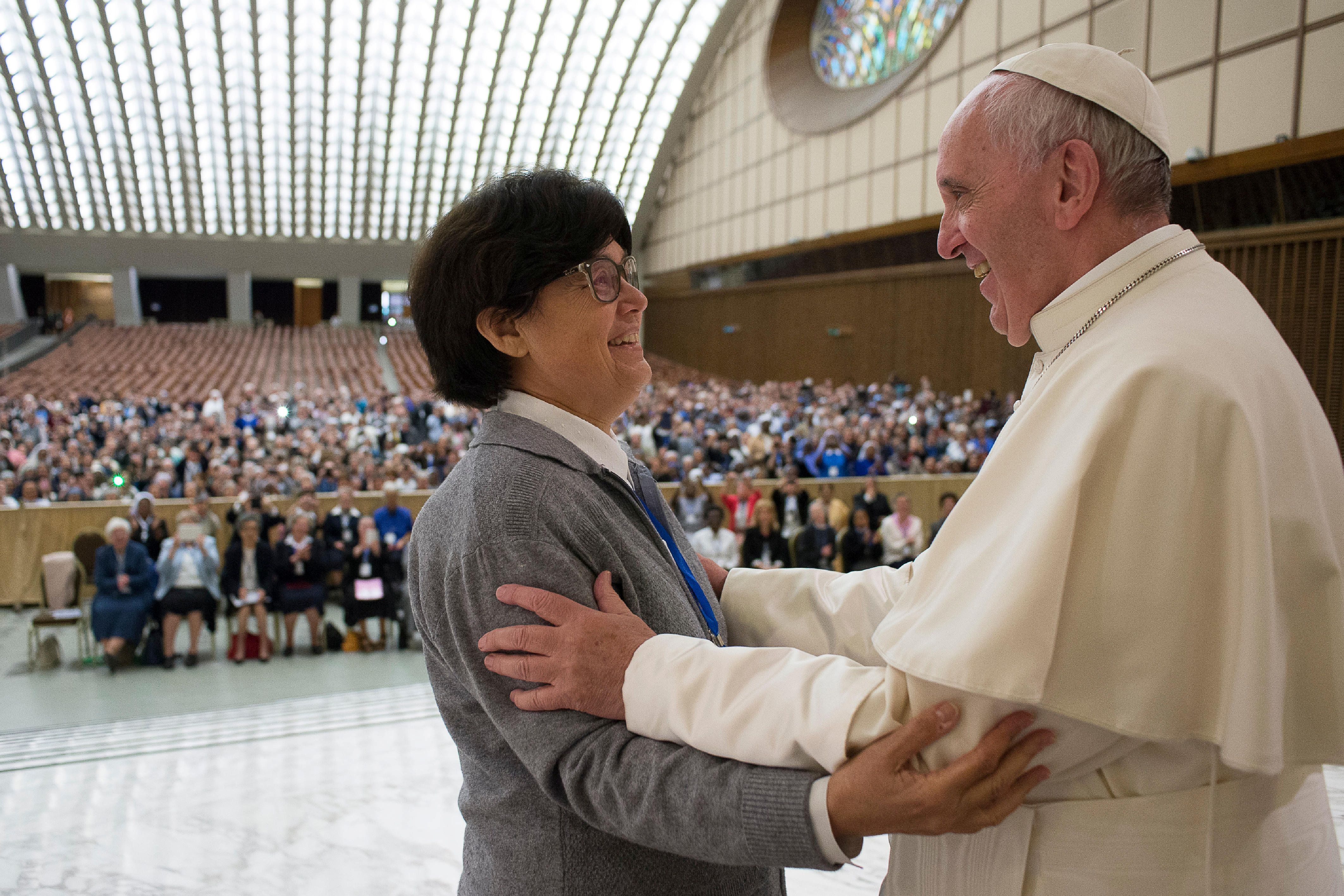 Pope Francis is greeted by Sister Carmen Sammut, a Missionary Sister of Our Lady of Africa, during an audience with UISG (International Union of Superiors General) at the Vatican, May 12, 2016. Osservatore Romano/Handout via Reuters   ATTENTION EDITORS - THIS IMAGE WAS PROVIDED BY A THIRD PARTY. EDITORIAL USE ONLY. NO RESALES. NO ARCHIVE.