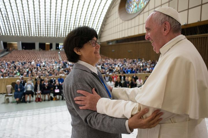Pope Francis is greeted by Sister Carmen Sammut, a Missionary Sister of Our Lady of Africa, during an audience with the
