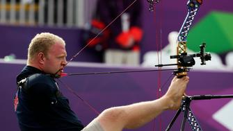 Matt Stutzman of the U.S. uses his feet to support his bow and his teeth to fire the arrow during the Archery Men's Individual Compound - Open at the London 2012 Paralympic Games August 31, 2012. The London Paralympics is hosting the biggest number of athletes since its inception in 1960 at the Rome Games, with 4,280 competitors representing 164 nations compared to 400 participants from 23 countries in the Italian capital REUTERS/Olivia Harris (BRITAIN - Tags: SPORT OLYMPICS)
