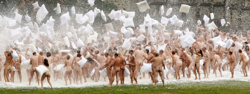 Naked volunteers battle with pillows as they pose for U.S. artist Spencer Tunick in front of the Gaasbeek's Castle on July 9,