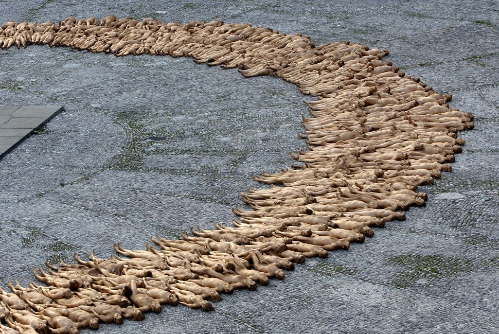Naked volunteers, numbering around 1,700 people, pose for U.S. artist Spencer Tunick in downtown Munich on June 23, 2012.&nbs