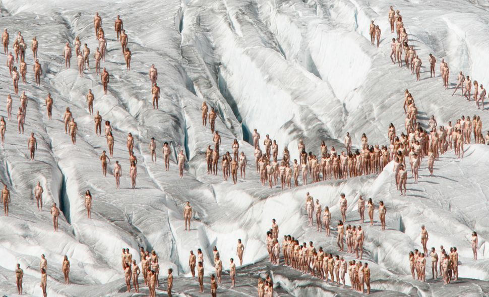 Naked volunteers pose for U.S. photographer Spencer Tunick on the Aletsch glacier on August 18, 2007. Tunick held the photo s