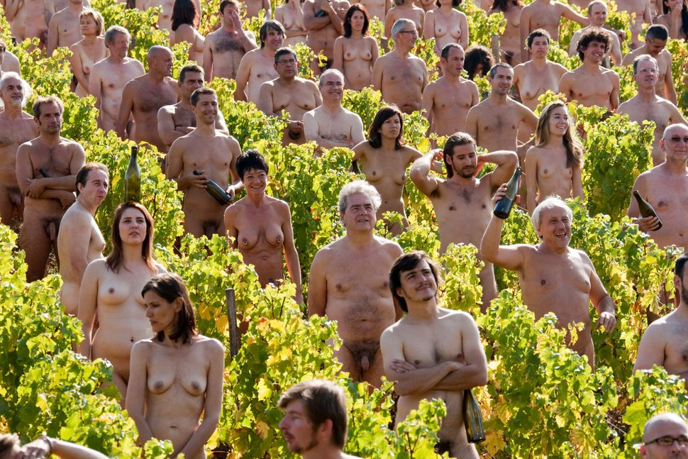 Naked volunteers pose for U.S. photographer Spencer Tunick in a vineyard of Pouilly-Fuisse in Fuisse on October 3, 2009. Tuni