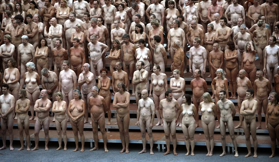 Hundreds of naked volunteers pose for U.S. photographer Spencer Tunick creating a three-dimensional body sculpture at the Mus