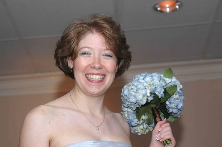 Lori Jackson, pictured at her sister's wedding in 2009, was shot by her estranged husband in Connecticut.
