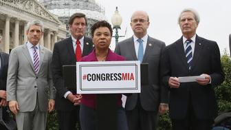 WASHINGTON, DC - MAY 12:  Rep. Barbara Lee, (D-CA),(C), is flanked by House colleagues while speaking the ISIL threat on Capitol Hill, May 12, 2016 in Washington, DC. Lee and a bi partisan group of House members are urging Congress to actively debate the ISIL threat, the cost and consequences of war, and the need for a comprehensive counter ISIL strategy.  (Photo by Mark Wilson/Getty Images)