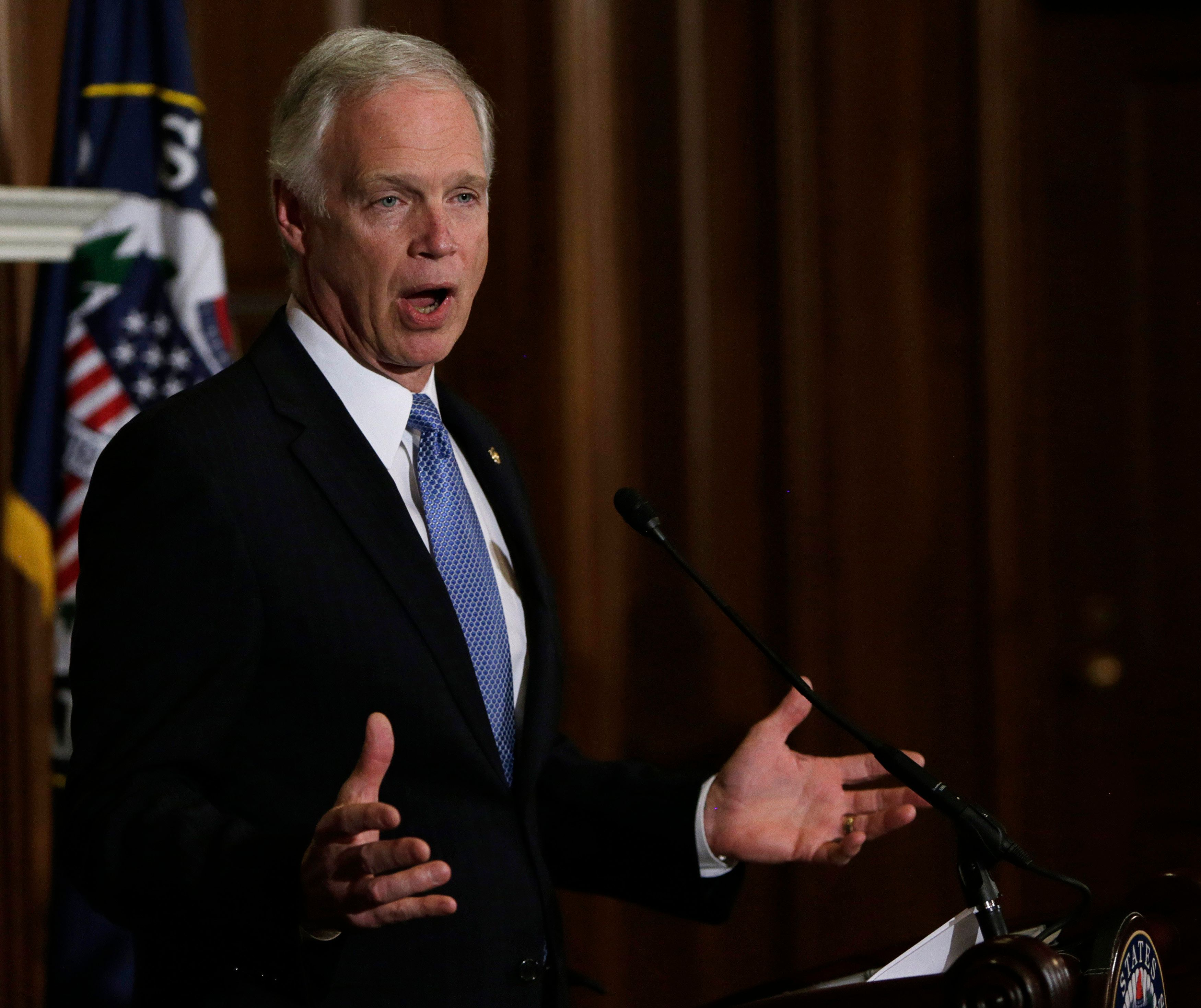 """U.S. Senator Ron Johnson (R-WI) speaks during a news conference on Capitol Hill in Washington January 6, 2014. Johnson planned to file a lawsuit on Monday challenging """"special treatment"""" for members of the U.S. Congress in the application of President Barack Obama's healthcare law. Johnson, of Wisconsin, wrote in the Wall Street Journal that the Obama administration exceeded its legal authority by arranging federal subsidies for members of Congress and their staff under the Affordable Care Act, known as Obamacare.  REUTERS/Gary Cameron    (UNITED STATES - Tags: POLITICS HEALTH)"""