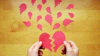 Hands putting broken hearts back together
