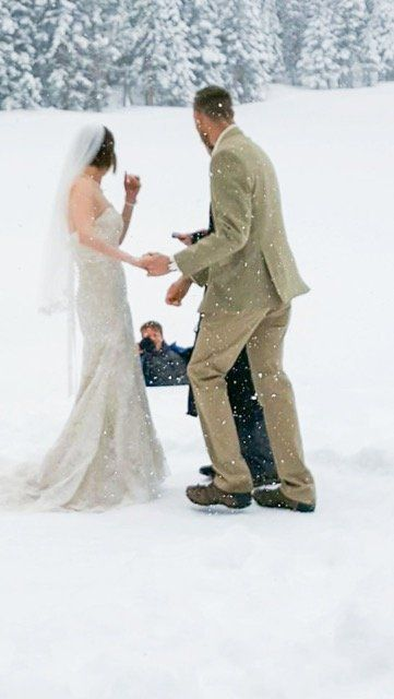 Brad and Tara Peters' wedding photographer fell into Bear Lake in the middle of their wedding ceremonyat...