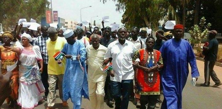 Protesters are seen marching on April 16 in Banjul. Gambia has seen rare demonstrations over electoral reforms and the i