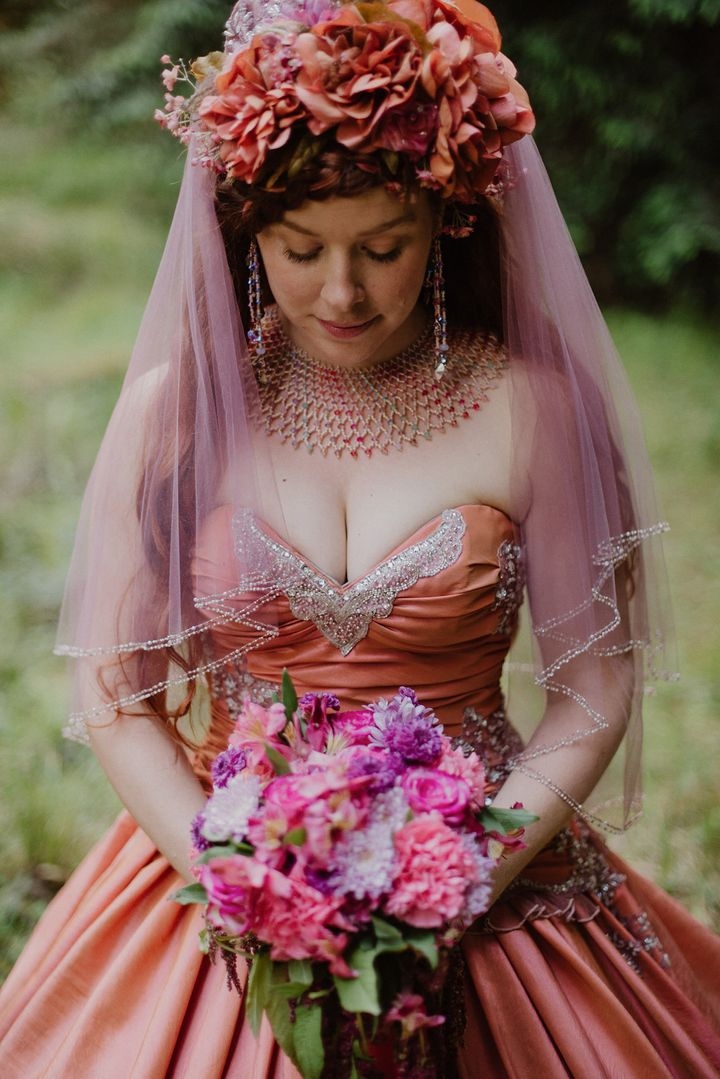 "The bride, <a href=""http://www.maidenmay.com/"" target=""_blank"">who designs costumes</a>, made some changes to the&nbsp;original gown&nbsp;by&nbsp;adding&nbsp;a&nbsp;bow in the back and creating a custom hoop skirt to go underneath."