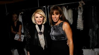 Comedienne Joan Rivers (L) and her daughter Melissa Rivers attend the Elie Tahari Fall/Winter 2011 collection show during New York Fashion Week February 16, 2011. REUTERS/Eric Thayer/File photo