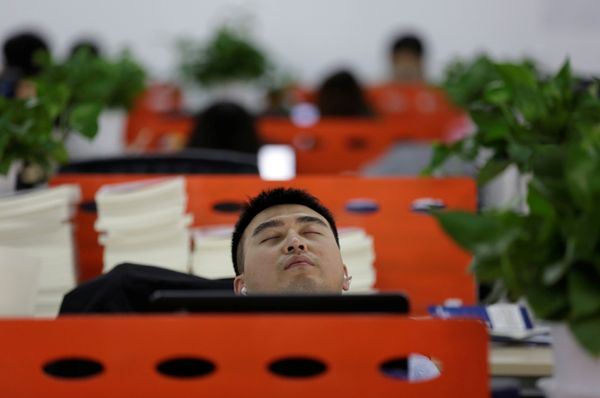 Cui Meng, a Co-founder of Goopal Group, takes a nap in his seat after lunch, in Beijing, China, April 21, 2016.