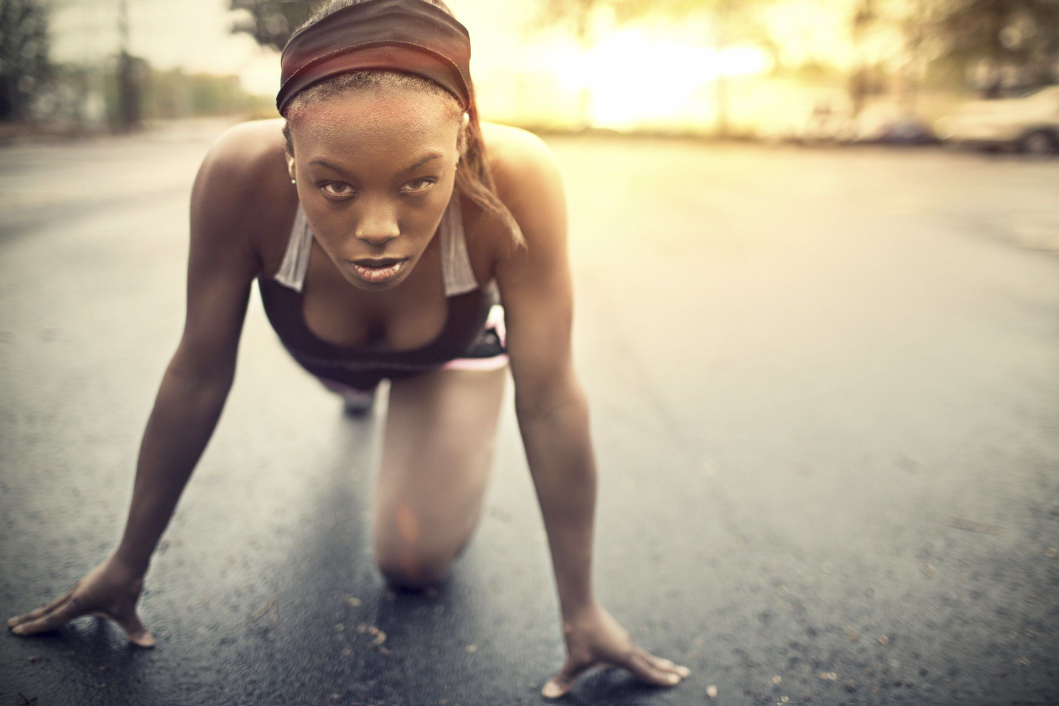 Portrait of a woman starting the jogging.