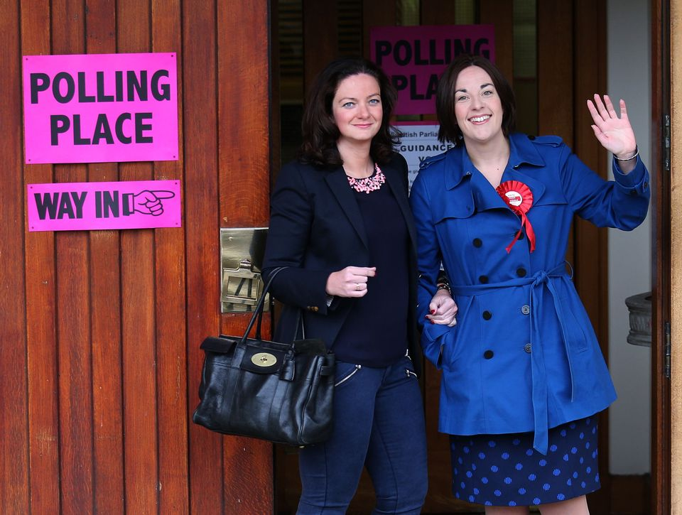 Kezia Dugale arrives with her partnerLouise Riddell at a polling station in