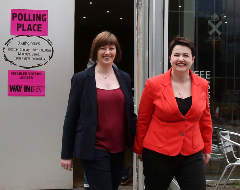 Ruth Davidson makes her way to a polling station inEdinburgh with partnerJen