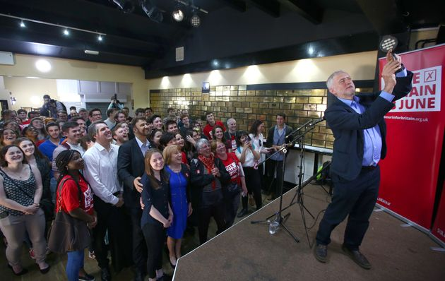 Jeremy Corbyn takes selfies with his