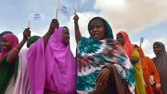Somali women dance to welcome United Nations High Commissioner for Refugees Antonio Guterres at IFO-2 complex of the sprawling Dadaab refugee camp on May 8, 2015. Dadaab refugee camp currently houses some 350,000 people and for more than 20 years has been home to generations of Somalis who have fled their homeland wracked by conflicts. But Kenya's government asked the UN refugee agency (UNHCR) to close the camp after an attack on Kenyas Garissa University by Somalia-based Al-Shabaab gunmen in April, whom are suspected to have planned and launched their attack from the camp.  AFP PHOTO / TONY KARUMBA        (Photo credit should read TONY KARUMBA/AFP/Getty Images)