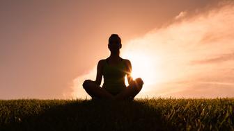 Woman meditating in yoga pose.