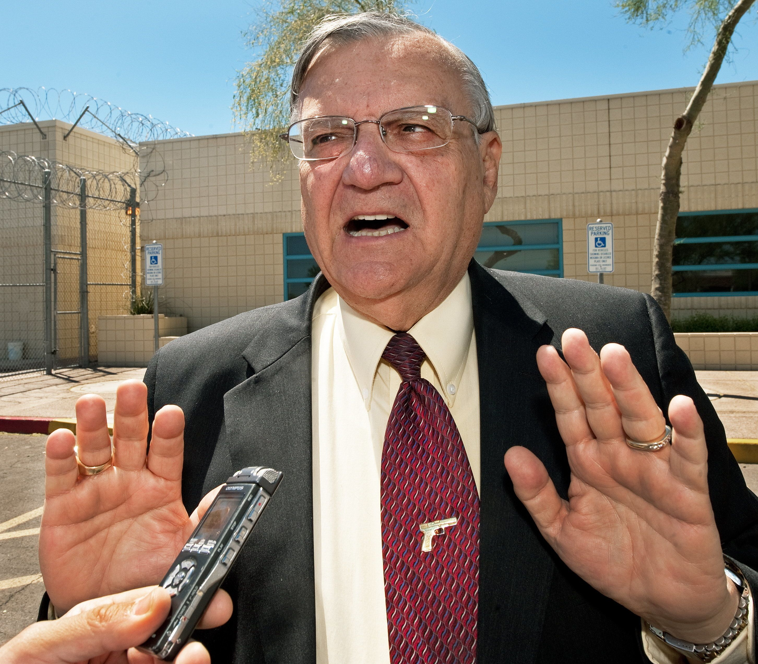 (FILES) Maricopa County Sheriff Joe Arpaio speaks with a reporter outside city jail in this May 3, 2010, file photo. The US Justice Department on May 10, 2012 sued Arpaio, his office and the county over civil rights violations involving racial profiling.   AFP Photo/Paul J. Richards/FILES        (Photo credit should read PAUL J. RICHARDS/AFP/GettyImages)