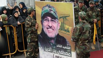 Members of Lebanon's Shiite militant group Hezbollah carry a portrait of Mustafa Badreddine, a top Hezbollah commander who was killed in an attack in Syria, during his funeral in the Ghobeiry neighbourhood of southern Beirut on May 13, 2016. Hezbollah announced that Badreddine had been killed in an attack in Syria where the Shiite militant group has deployed thousands of fighters in support of the Damascus regime. The group said it was still investigating the cause of the blast near Damascus airport but it did not immediately point the finger at Israel as it did when the commander's predecessor was assassinated in the Syrian capital in 2008.  / AFP / ANWAR AMRO        (Photo credit should read ANWAR AMRO/AFP/Getty Images)