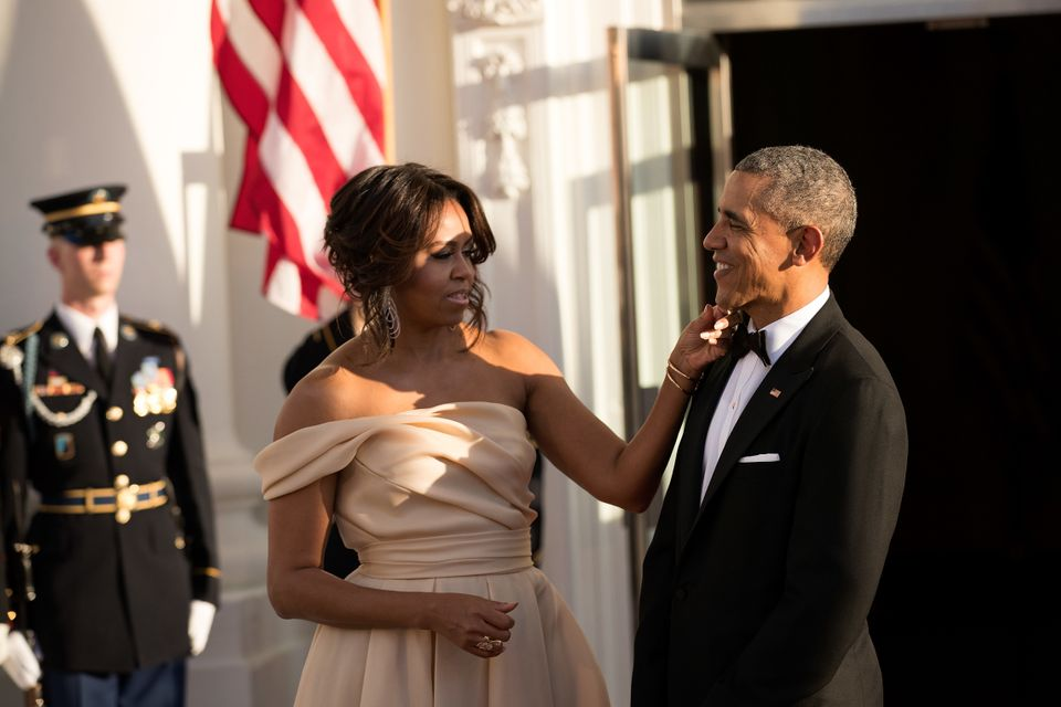 President Barack Obama and first lady Michelle Obama wait for guests to arrive.