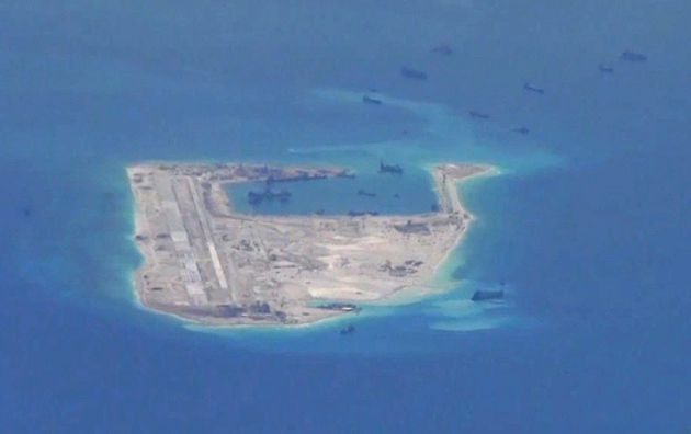 Chinese dredging vessels are purportedly seen in the waters around Fiery Cross Reef in the disputed Spratly...
