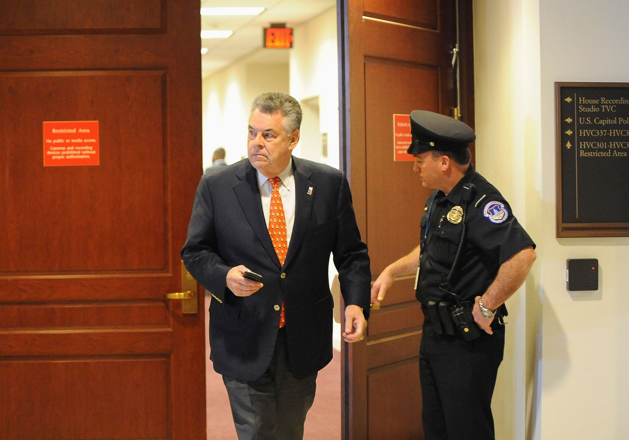 Rep. Peter King (R) leaves the hearing after U.S. General David Petraeus testified at the U.S. House Intelligence Committee meeting on the attack of the American Consulate in Benghazi on Capitol Hill in Washington November 16, 2012. Former CIA Director Petraeus testified Friday on Capitol Hill about the attack on the U.S. diplomatic mission in Benghazi, Libya, but also is expected to be asked about his resignation last week over an extramarital affair.       REUTERS/Mary F. Calvert (UNITED STATES - Tags: POLITICS)