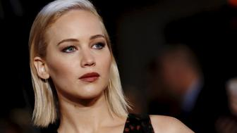 "Actress Jennifer Lawrence poses for photographers on the red carpet at the UK premiere of ""The Hunger Games: Mockingjay Part 2"" at Leicester Square in London, Britain November 5, 2015. REUTERS/Luke MacGregor"