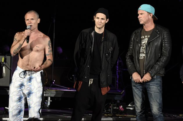 From left, band members Flea, Josh Klinghoffer and Chad Smith took the stage to announce that they would...