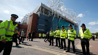 "Britain Soccer Football - Manchester United v AFC Bournemouth - Barclays Premier League - Old Trafford - 15/5/16 General view of police outside the stadium after the match was abandoned Reuters / Andrew Yates Livepic EDITORIAL USE ONLY. No use with unauthorized audio, video, data, fixture lists, club/league logos or ""live"" services. Online in-match use limited to 45 images, no video emulation. No use in betting, games or single club/league/player publications.  Please contact your account representative for further details."