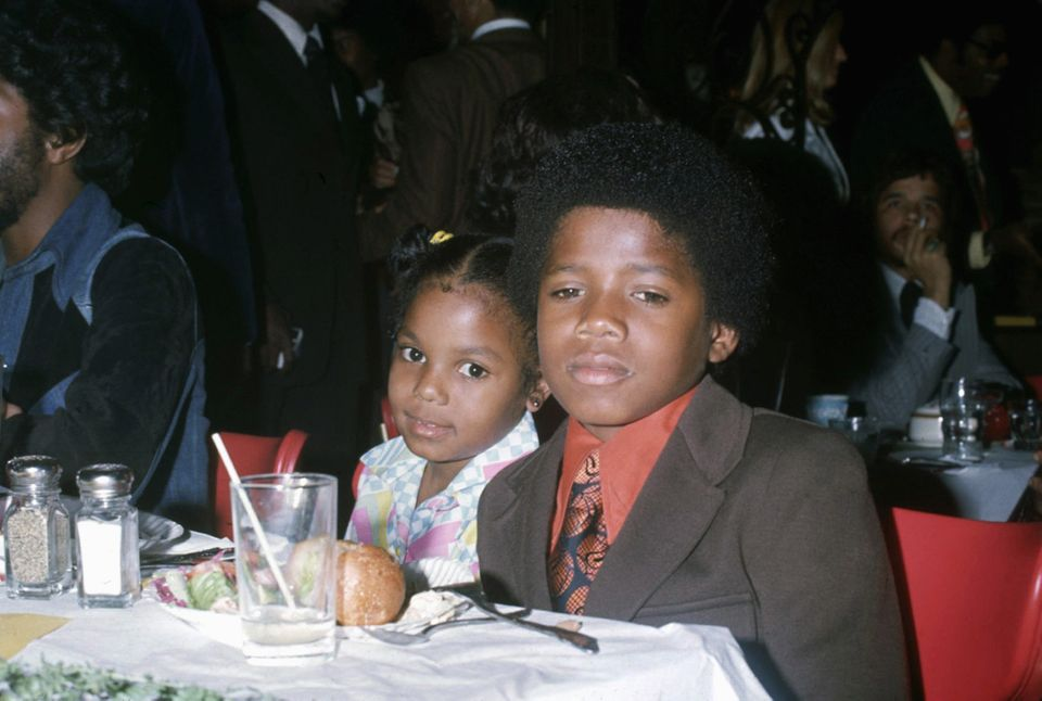 With her brother Randy Jackson.