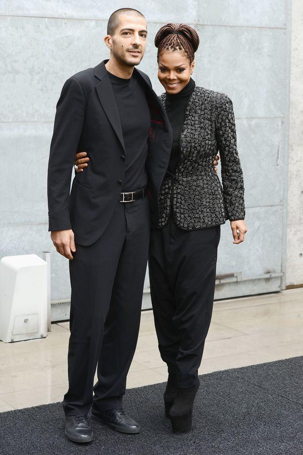 With ex-husband Wissam al Mana attend the Giorgio Armani fashion show during Milan Fashion Week in Milan.
