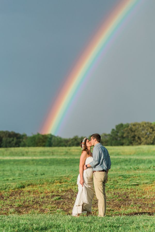 """A beautiful sun shower produced one of the most vivid rainbows anyone had ever seen at Brandon and Jodi's Camp Willow Spring"