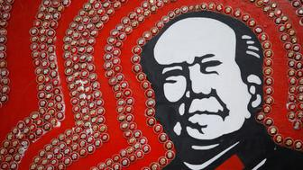 "Badges of late Chinese Chairman Mao Zedong decorate an image of Mao at Jianchuan Museum Cluster in Anren, Sichuan Province, China, May 13, 2016. Tucked away in southwestern China's Sichuan province, a private collector stands virtually alone in exhibiting relics from the 1966-1976 Cultural Revolution. Monday marks the 50th anniversary of the start of the political movement, with no official commemorations planned. Official records whitewash the details of both periods, but admit that Mao made major mistakes. REUTERS/Kim Kyung-Hoon FOR EDITORIAL USE ONLY. NO RESALES. NO ARCHIVES. SEARCH ""CULTURAL KIM"" FOR THIS STORY. SEARCH ""THE WIDER IMAGE"" FOR ALL STORIES?"
