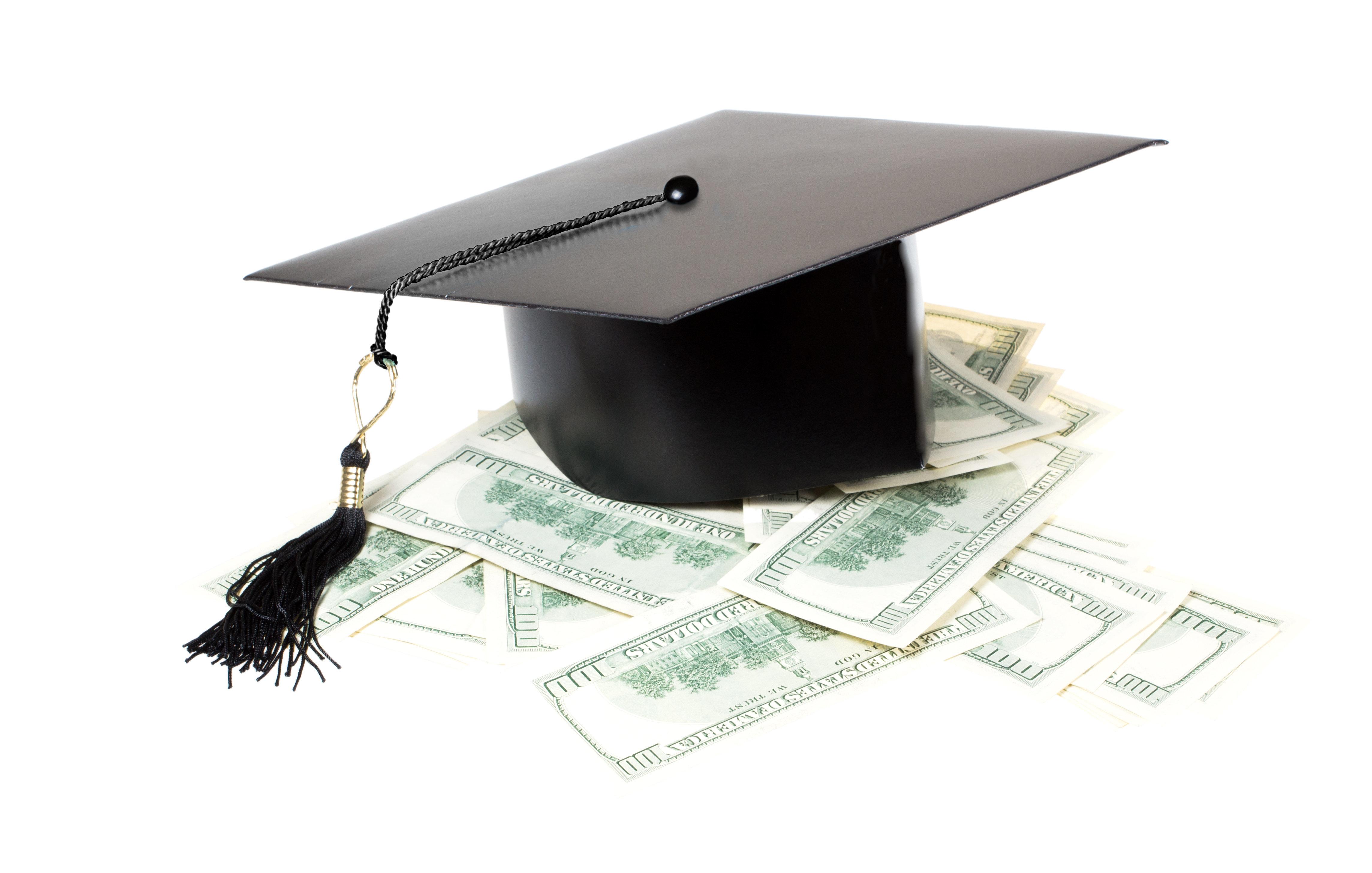 Paid education. Graduate cap on a pile of money