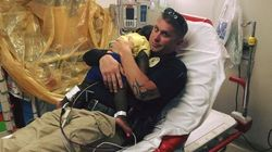 Sweet Photo Of Cop Comforting Toddler In Hospital Goes