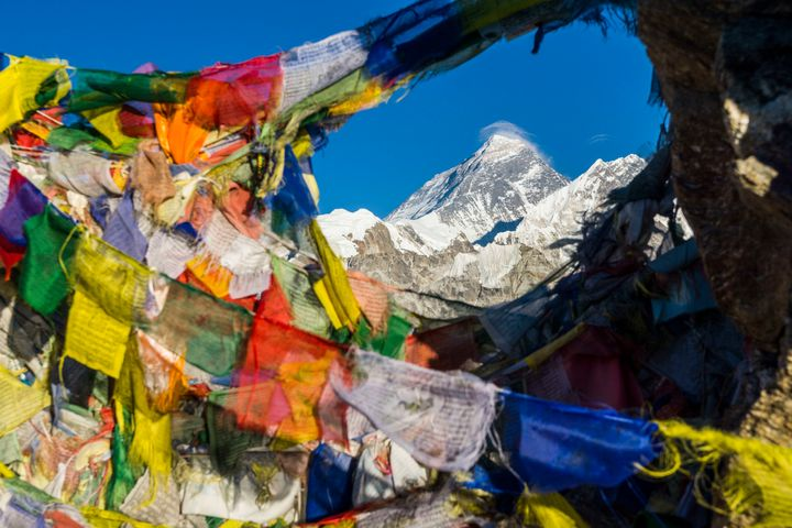 Prayer flags are seen hanging in the foreground of Mt. Everest. Chinese officials say they are going to start blacklisting th