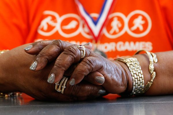 Natalie Pyle fold her hands during the Bid Whist card game competition during the Brooklyn Senior Games at the St. Johns Recr