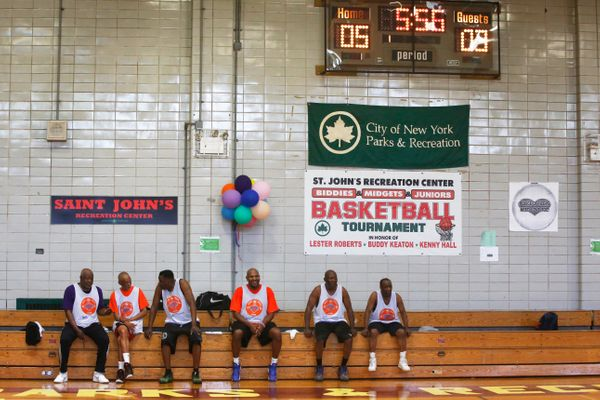 Seniors rest in between quarters of a basketball game during the Brooklyn Senior Games at the St. Johns Recreation Center in