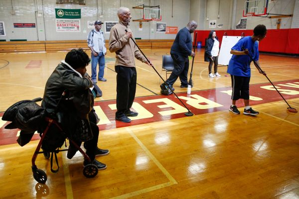 Seniors compete in shuffleboard games during the Brooklyn Senior Games at the St. Johns Recreation Center in New York, U.S.,