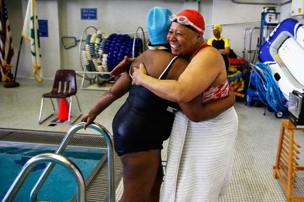 Carolyn Pratt, 63, embraces Hyacinth Constance, 62, after competing in a swimming heat during the Brooklyn Senior Games at th