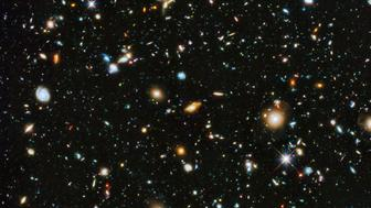 A colorful deep space image captured by the Hubble Space Telescope is seen in a NASA handout released June 3, 2014. Researchers say the image, from a new study called the Ultraviolet Coverage of the Hubble Ultra Deep Field, provides the missing link in star formation. The Hubble Ultra Deep Field 2014 image is a composite of separate exposures taken in 2003 to 2012 with Hubble's Advanced Camera for Surveys and Wide Field Camera 3.  REUTERS/NASA/ESA/Handout via Reuters (OUTER SPACE - Tags: ENVIRONMENT SCIENCE TECHNOLOGY)   ATTENTION EDITORS - FOR EDITORIAL USE ONLY. NOT FOR SALE FOR MARKETING OR ADVERTISING CAMPAIGNS. THIS IMAGE HAS BEEN SUPPLIED BY A THIRD PARTY. IT IS DISTRIBUTED, EXACTLY AS RECEIVED BY REUTERS, AS A SERVICE TO CLIENTS