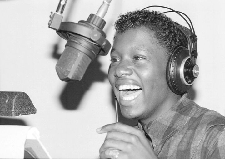 Johnny Gill sings in a recording studio in 1983.