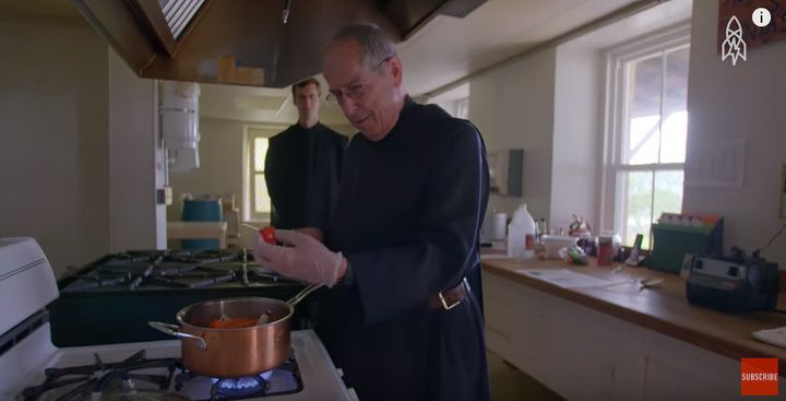 Father Richard Walz uses gloves to handle a hot Habanero pepper.