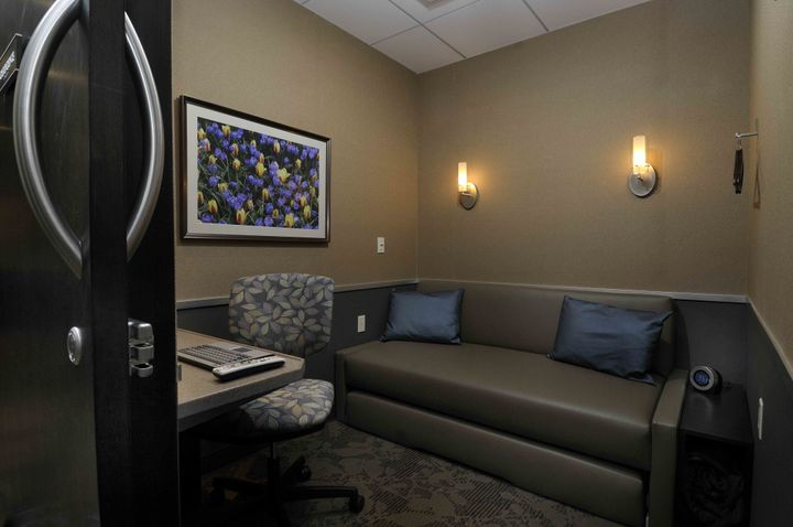 Each soundproofed Minute Suite features a day bed with a pullout trundle bed, a 32-inch flat screen TV and adjustable tempera