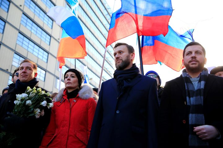 Navalny accused the police of doing nothing to stop the violence and having helped plan the attack. Here, he attends a march