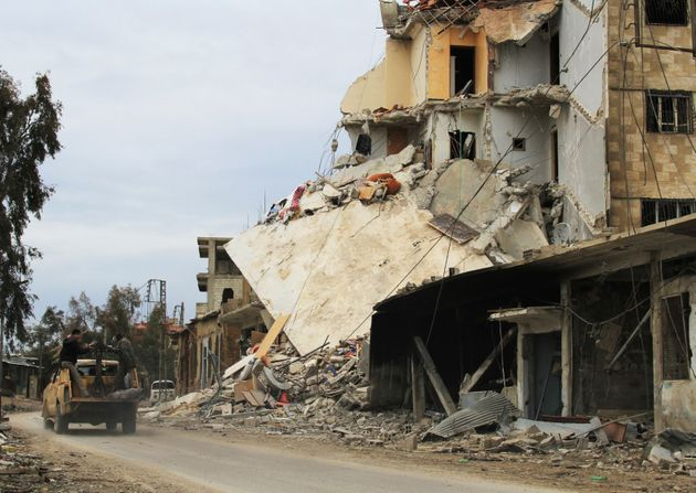Rebel fighters and officials believe that Syrian government forces are preparing an assault on the town...