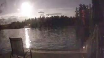 One video captured the massive fireball lighting up a lake.