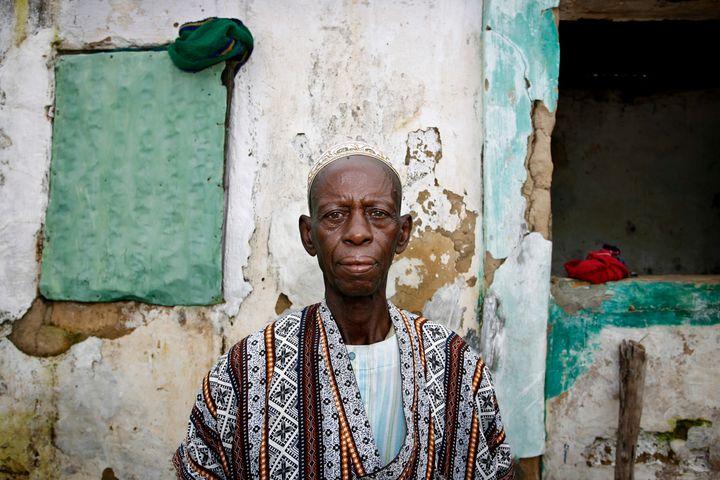 Djime Diallo, chief of the western Senegalese village ofDiabougo, poses in 2007. Diabougo wasthe second village i